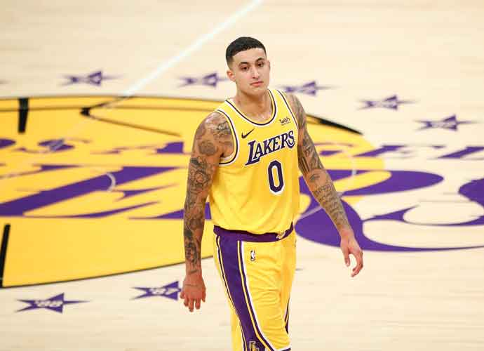LOS ANGELES, CALIFORNIA - FEBRUARY 20: Kyle Kuzma #0 of the Los Angeles Lakers looks on during the game against the Miami Heat at Staples Center on February 20, 2021 in Los Angeles, California. NOTE TO USER: User expressly acknowledges and agrees that, by downloading and or using this photograph, User is consenting to the terms and conditions of the Getty Images License Agreement. (Photo by Meg Oliphant/Getty Images)
