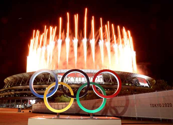 TOKYO, JAPAN - JULY 23: The Olympic Rings are seen outside the stadium as fireworks go off during the Opening Ceremony of the Tokyo 2020 Olympic Games at Olympic Stadium on July 23, 2021 in Tokyo, Japan. (Photo by Lintao Zhang/Getty Images)